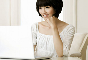 Young Woman Using a Laptop at Home